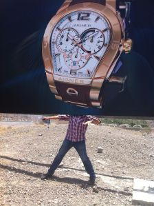 aigner watch face as face, advertisement in the mountains of fujayrah, UAE