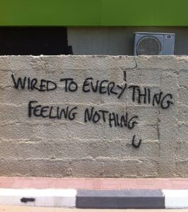 Text Graffiti in Dubai: Wired to Everything Feeling Nothing